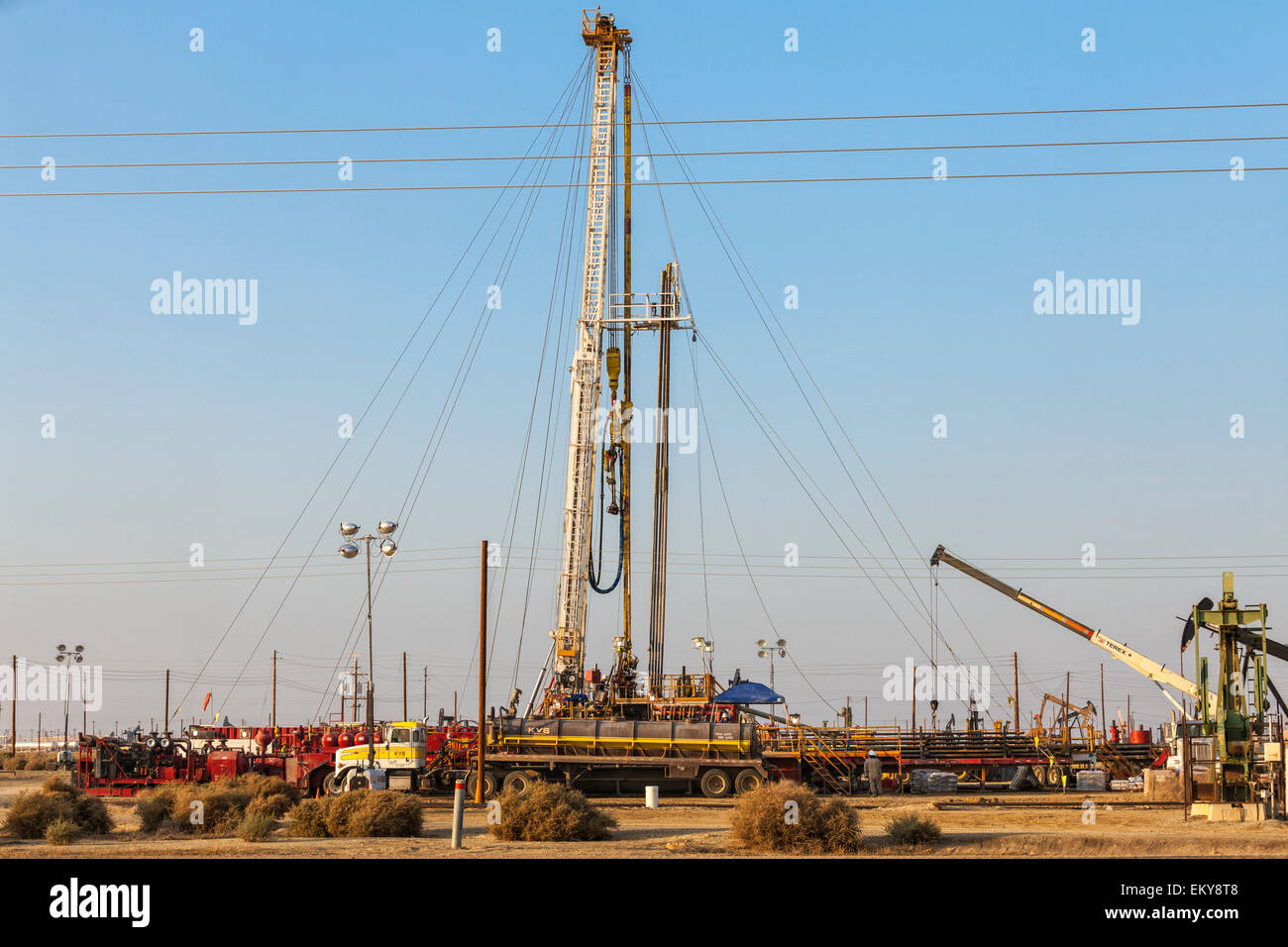 Well stimulation activity on oil well. Lost Hills Oil Field and hydraulic fracking site, Monterey Shale. Kern County, - Stock Image
