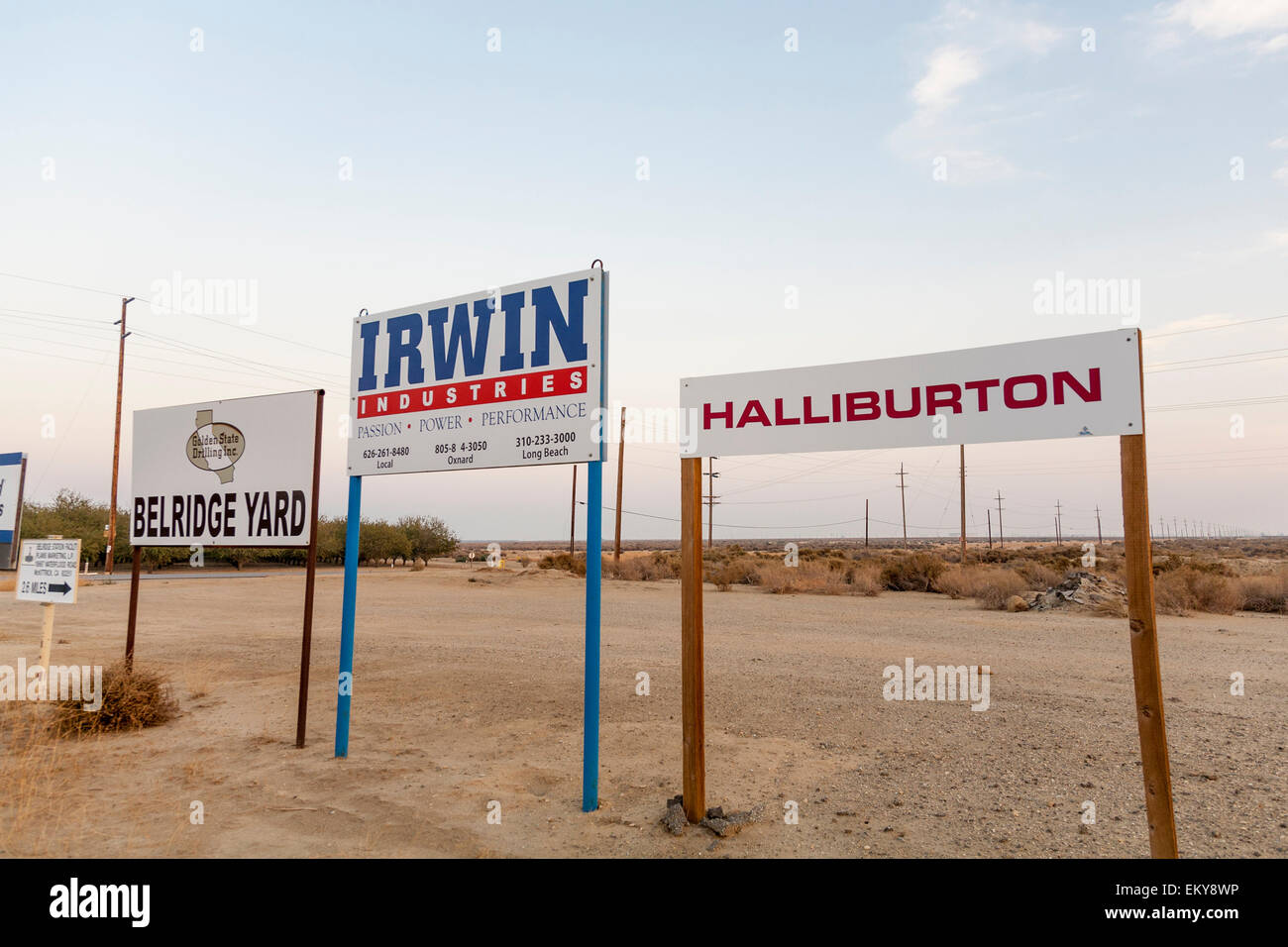 Company signs at Belridge Oil Field and hydraulic fracking site which is the fourth largest oil field in California. - Stock Image