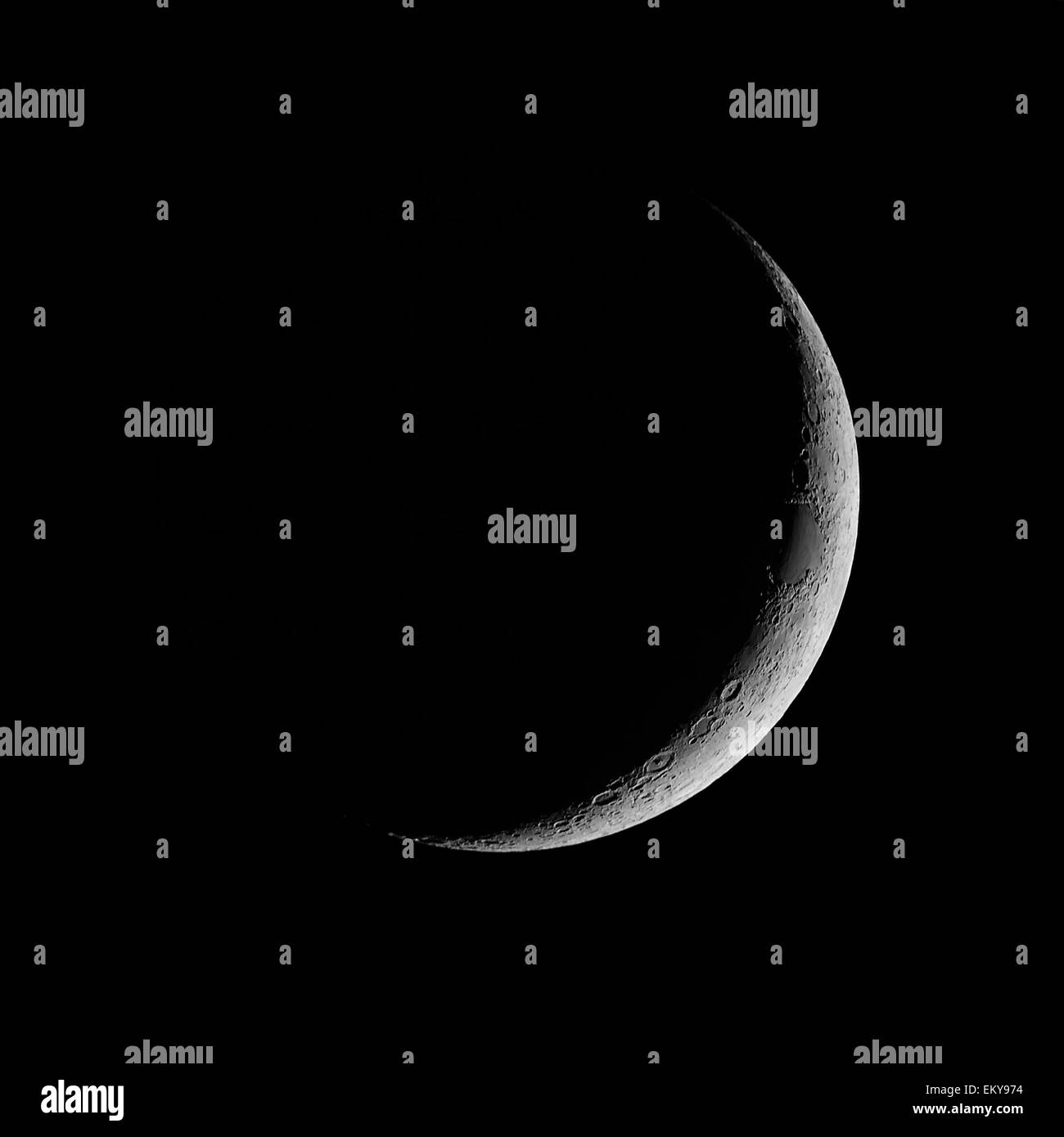 Waxing Crescent, crescent moon against black night sky - Stock Image