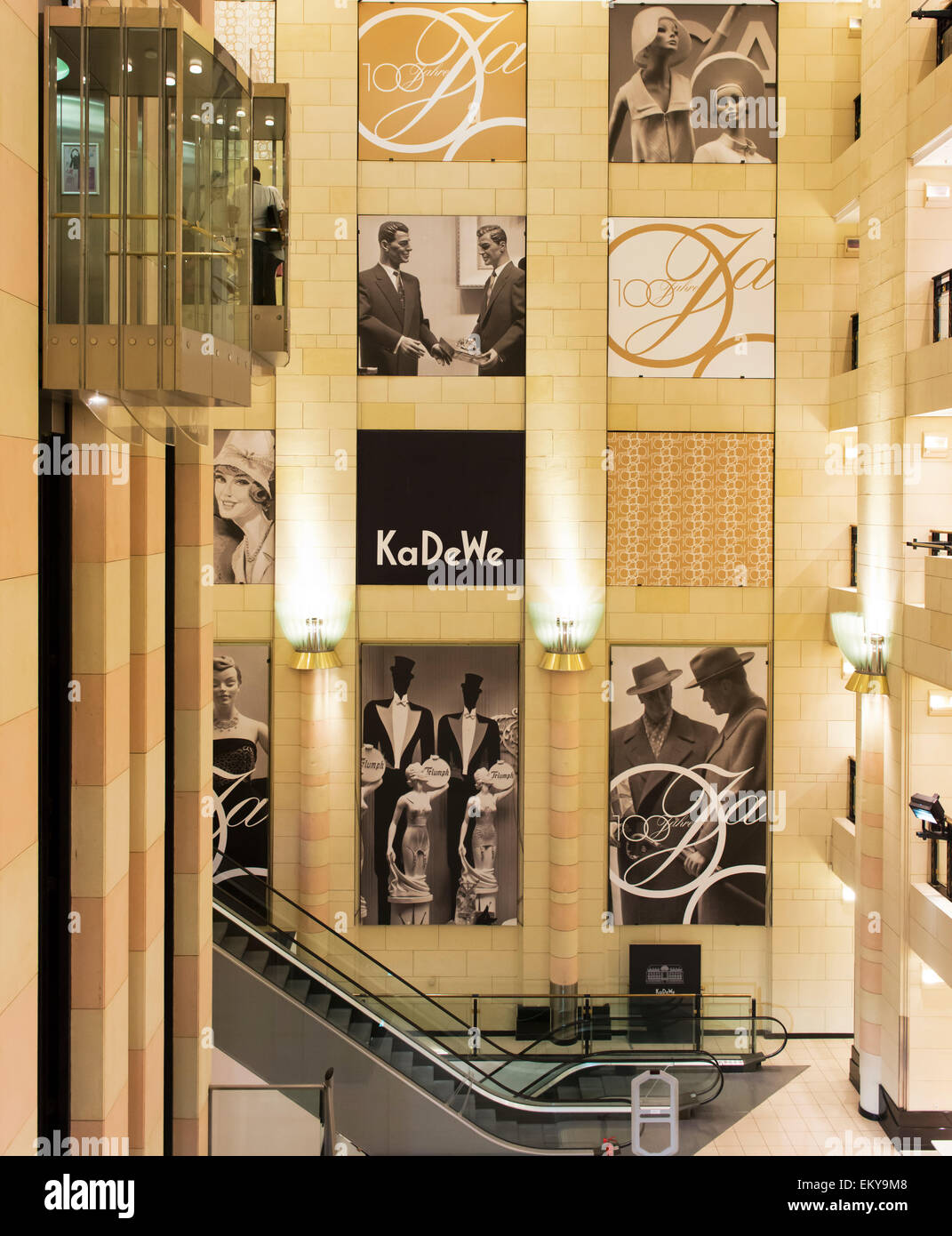 Elevators, escalators and displays at KaDeWe, a historic and upmarket department store, with views over Berlin. - Stock Image