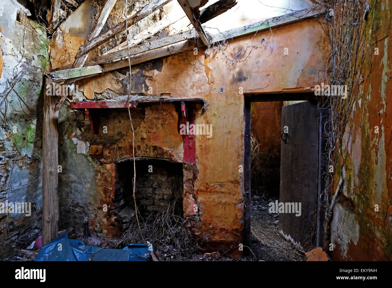The ruined and Shabby interior of old abandoned gate lodge house in west Cork Ireland - Stock Image
