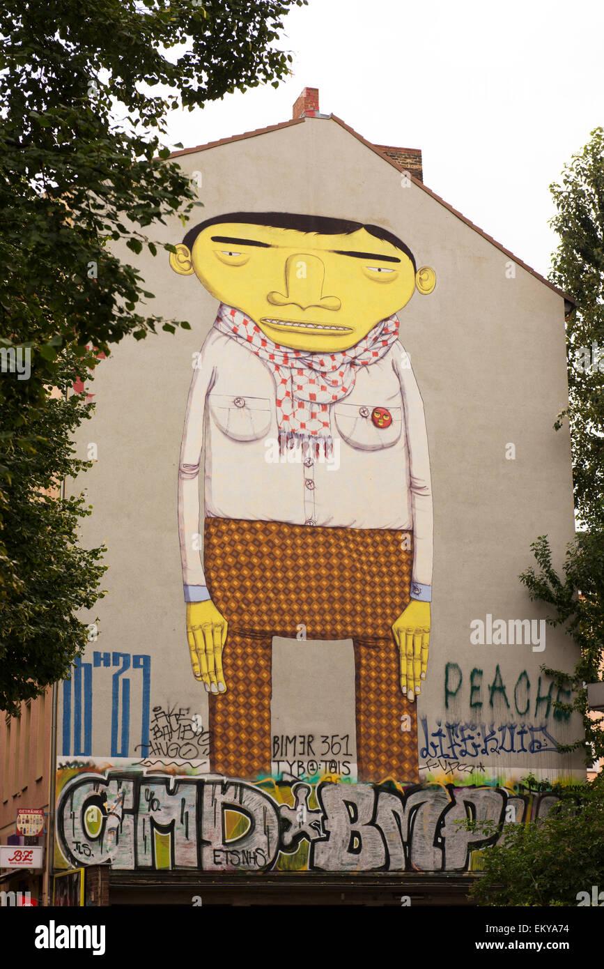 Yellow Man by Blu, an Italian street artist, in Kreuzberg. - Stock Image