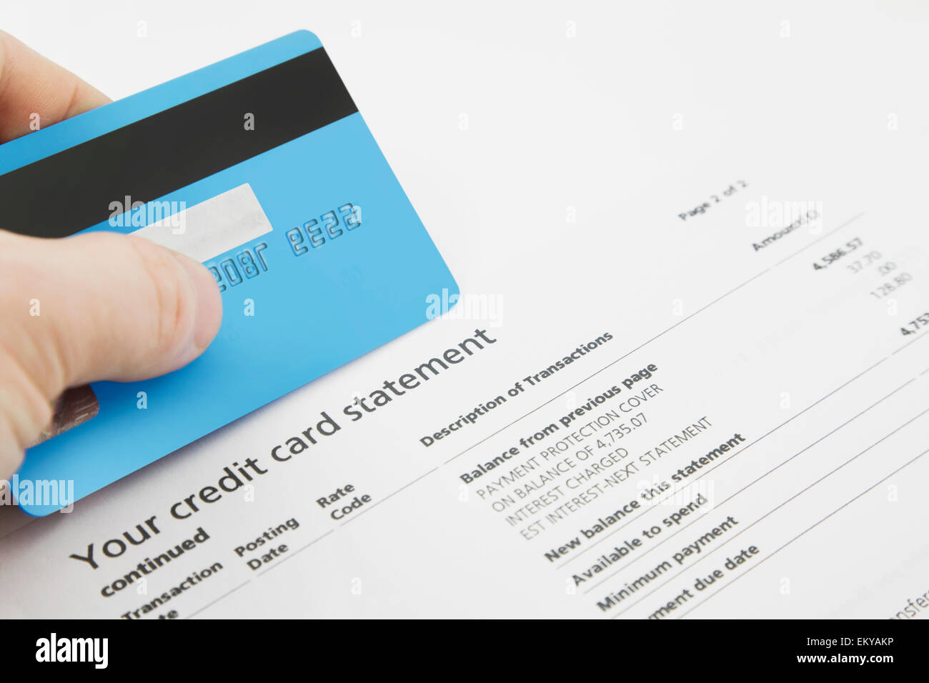 A Credit Card On Top Of A Fake Bank Statements Stock Photo