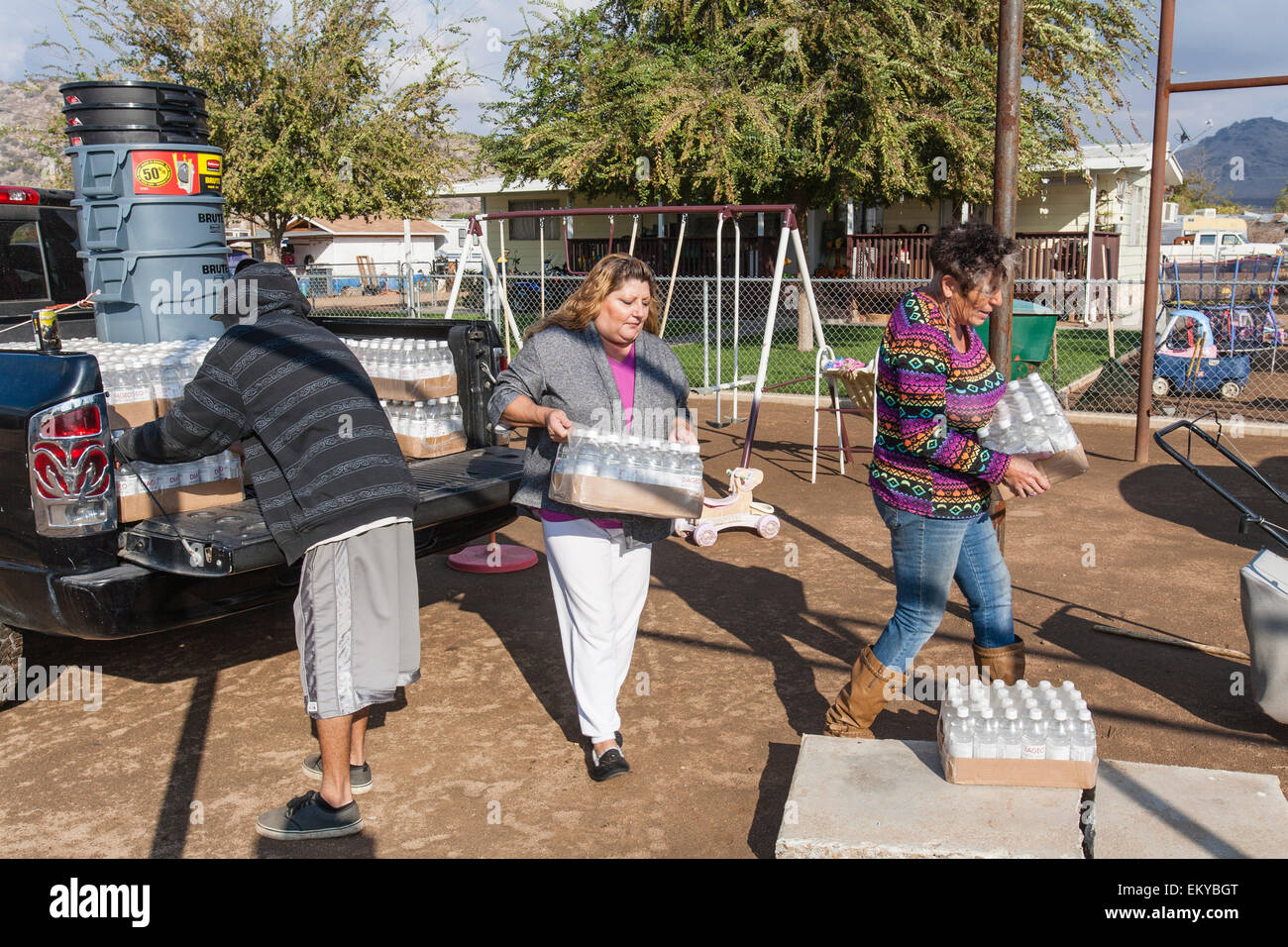 Donna Johnson, a 72 year old resident of East Porterville, California, delivers water to residents who had their - Stock Image