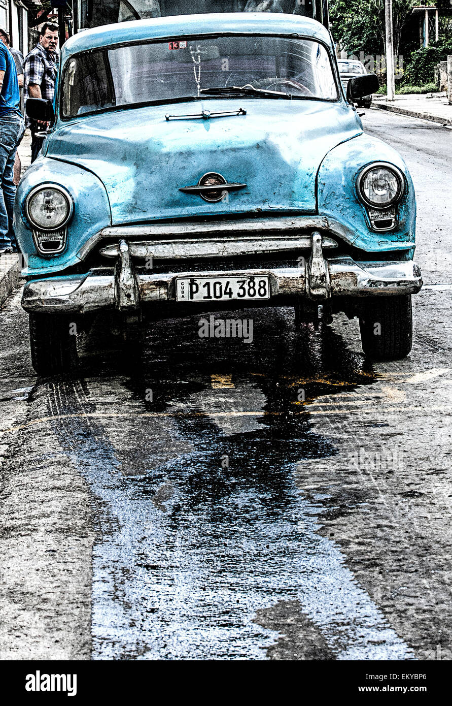 Car Leaking Oil >> Old American Blue Car With A Major Oil Leak And Oil Leaking Downhill