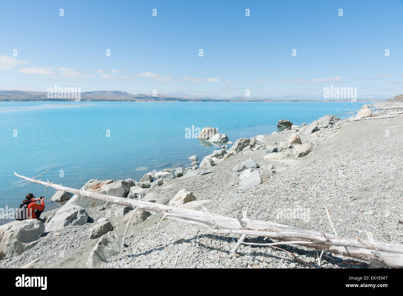 Lake Pukaki, Canterbury, South Island New Zealand. The turquoise water, blue sky and grey stony foreshore with a - Stock Image
