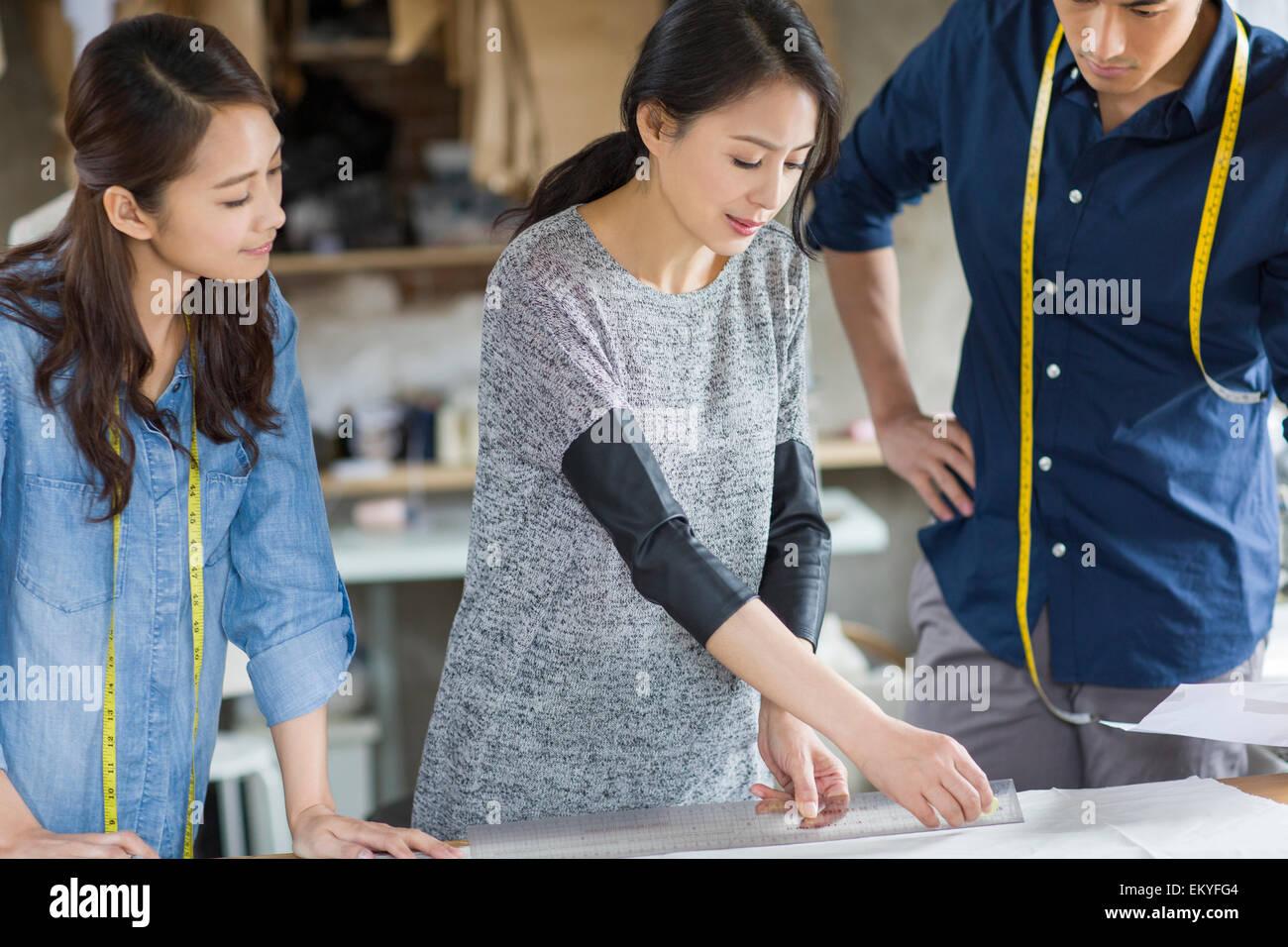 Fashion designers working in studio - Stock Image