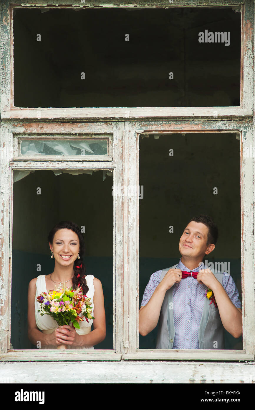 cheerful wedding couple having fun outdoors on wedding day. couple in love. happy bride and groom Stock Photo
