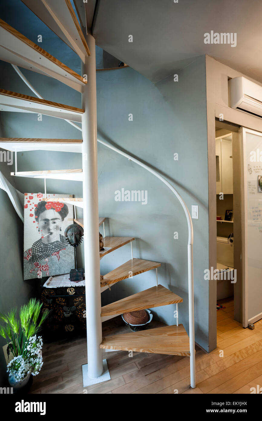Spiral Staircase In Entrance Area. Mongdang House (Extreme Small House),  Seoul, Korea, South. Architect: AnL Studio, 2012.