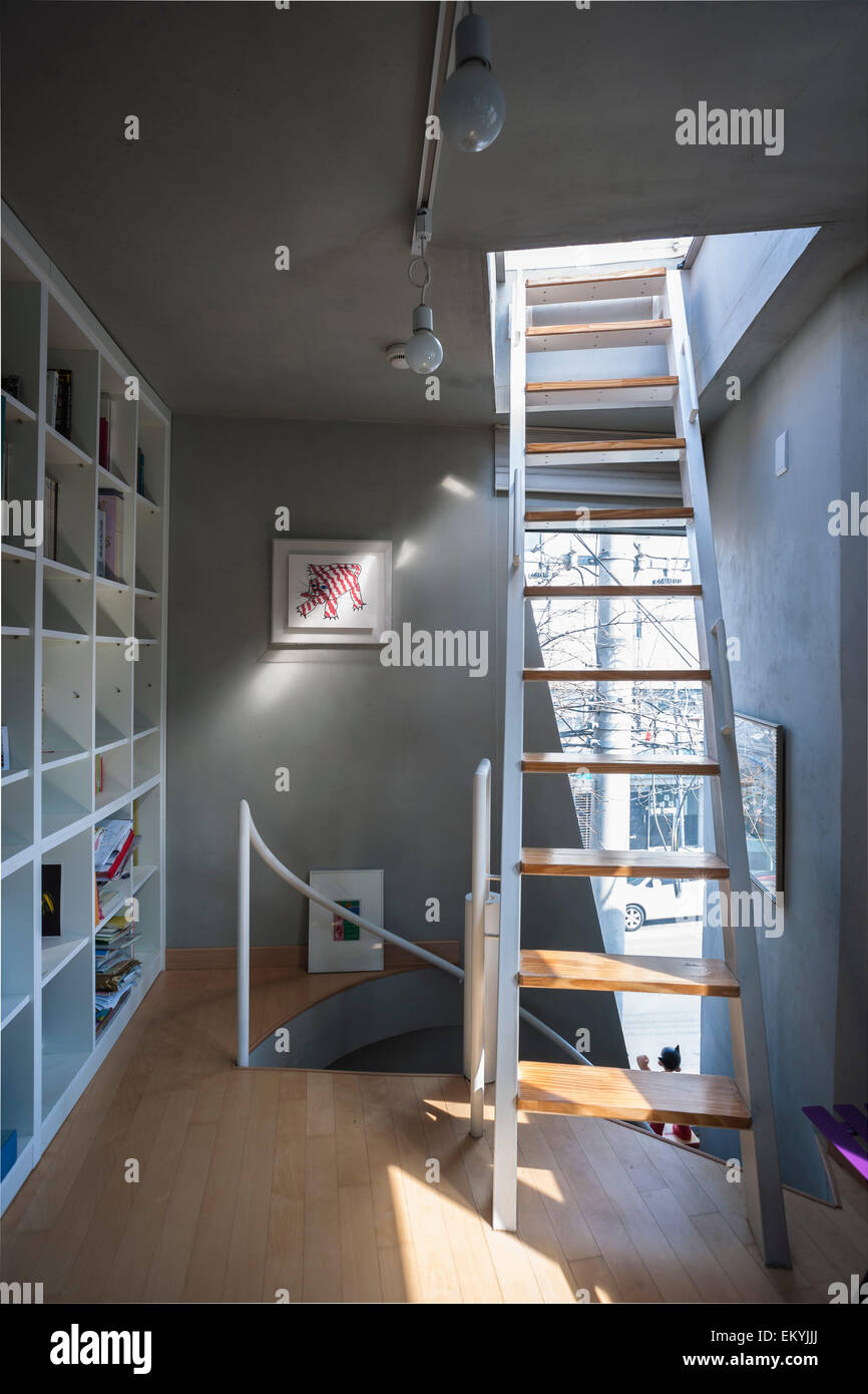 View Of Top Floor With Staircase Leading To Roof Terrace. Mongdang House  (Extreme Small House), Seoul, Korea, South. Architect: