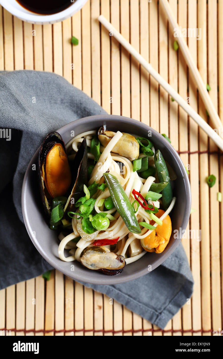 Chinese noodles with mussels in a bowl, food - Stock Image