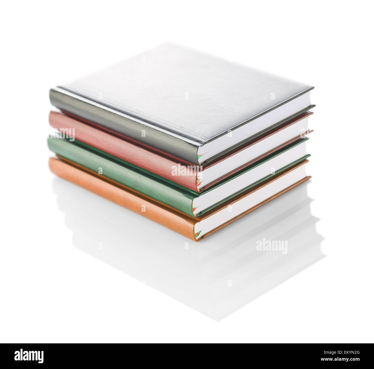 stack of four diaries isolated - Stock Image