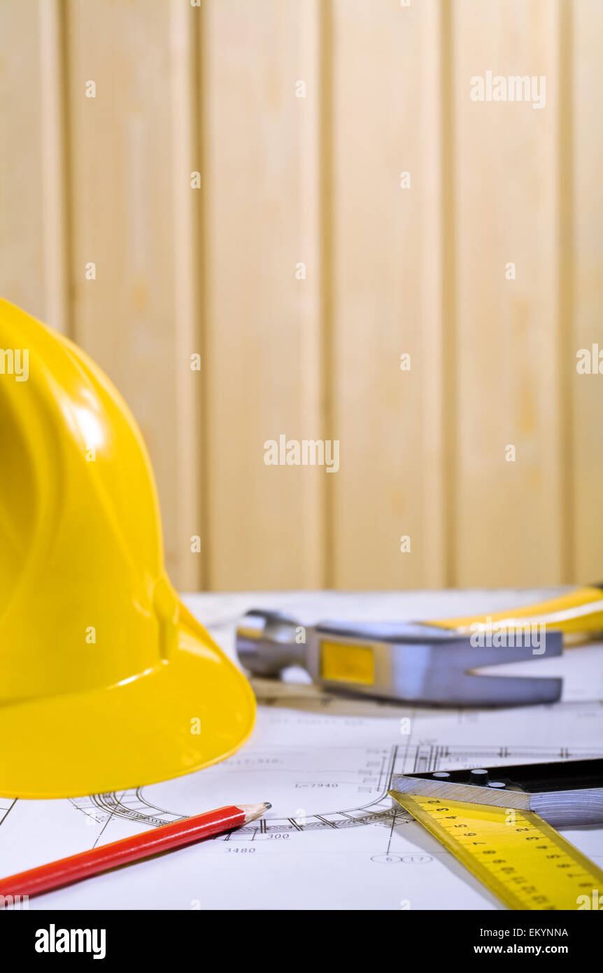 composition of helmet, pencil, angle ruller and claw hammer - Stock Image