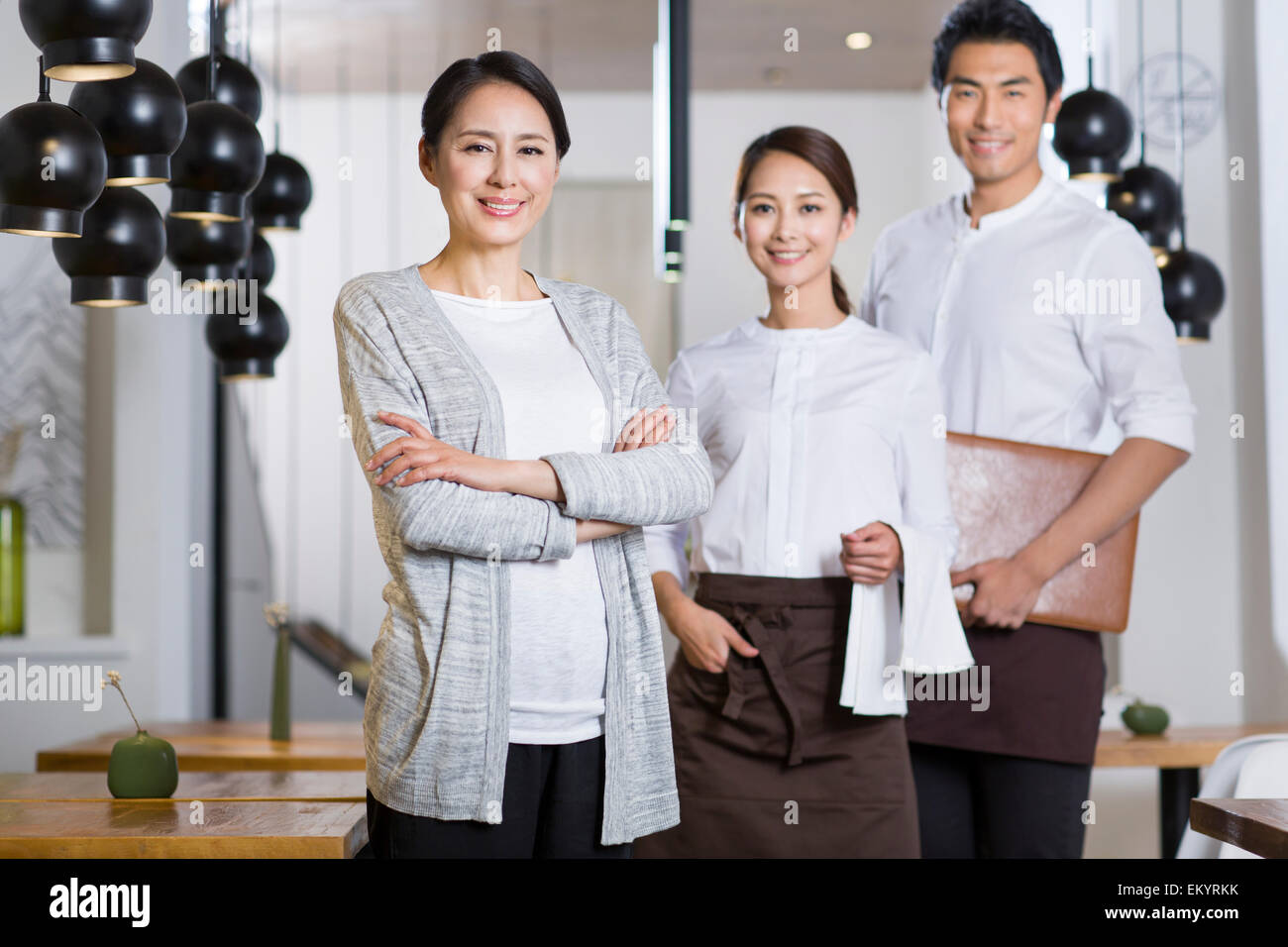 Restaurant owner and wait staff - Stock Image
