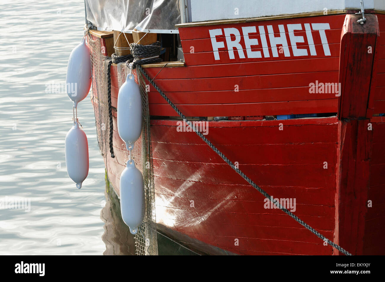 Red bow of the fishing boat named 'Freiheit', Mecklenburg-Western Pomerania, Germany - Stock Image