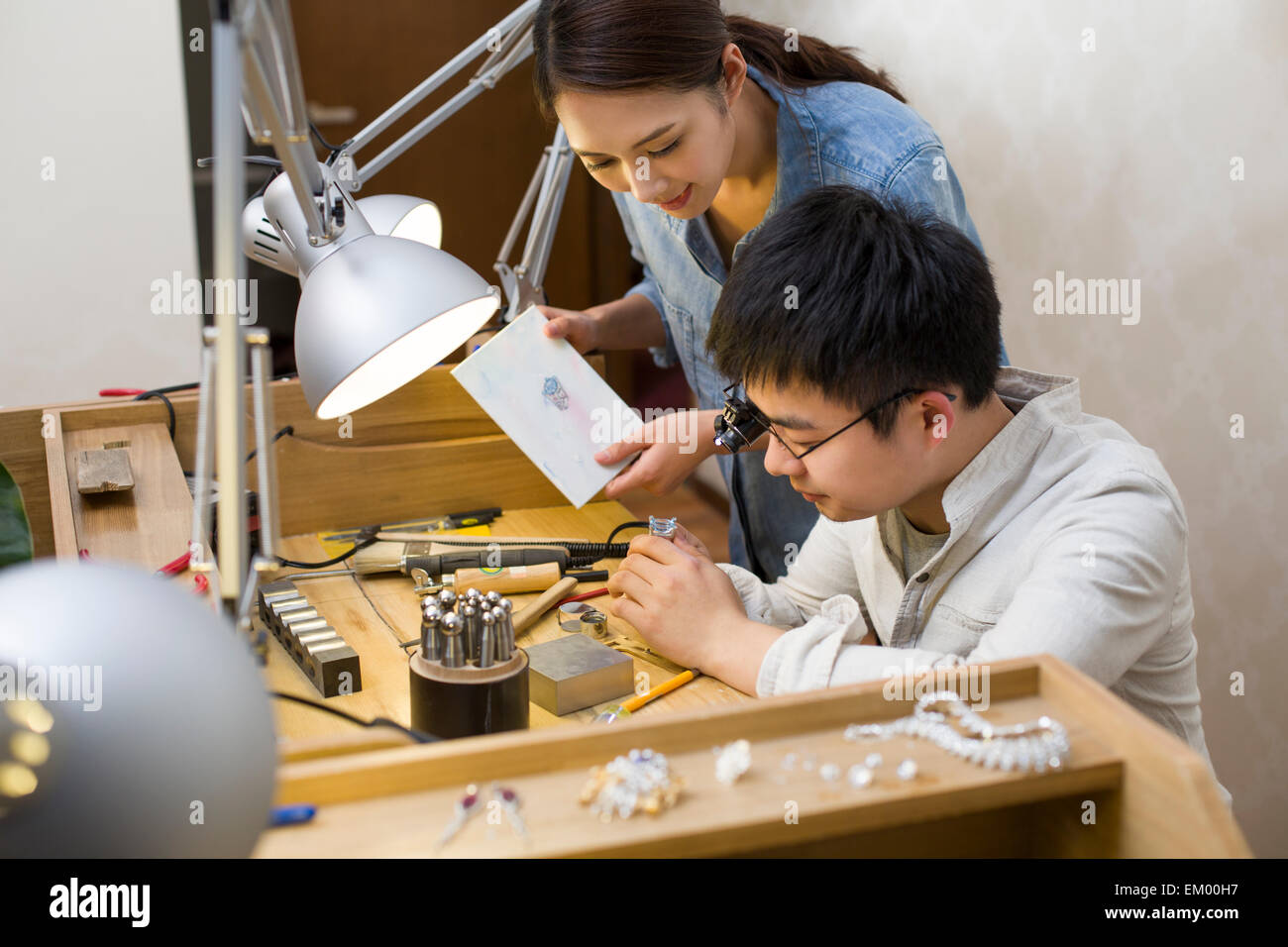 Jewelers making a sapphire ring - Stock Image