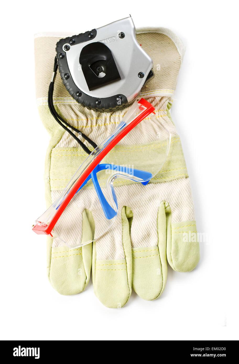 gloves safety glasses and yardstick - Stock Image