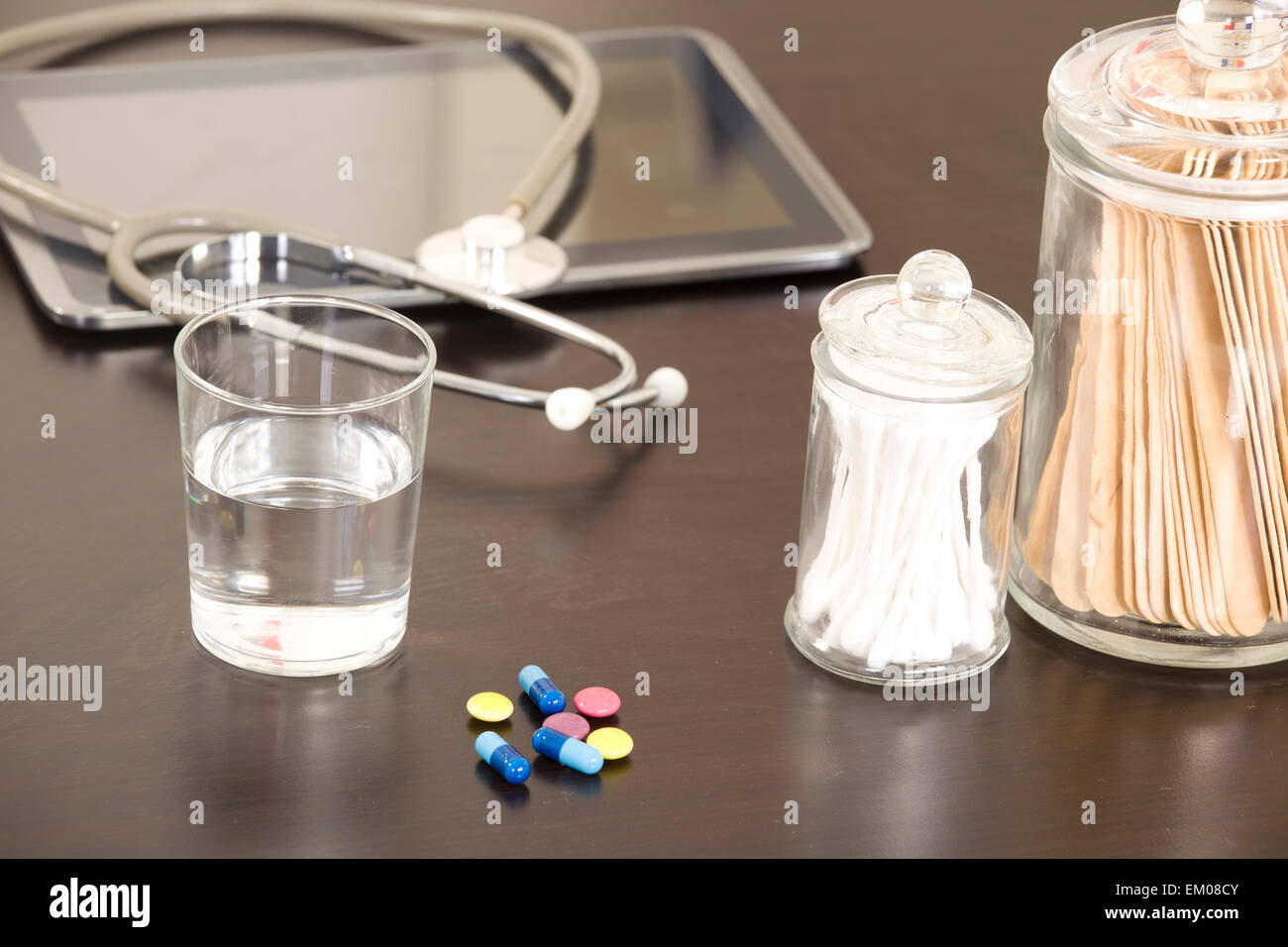 Doctor workplace with digital tablet and stethoscope - Stock Image