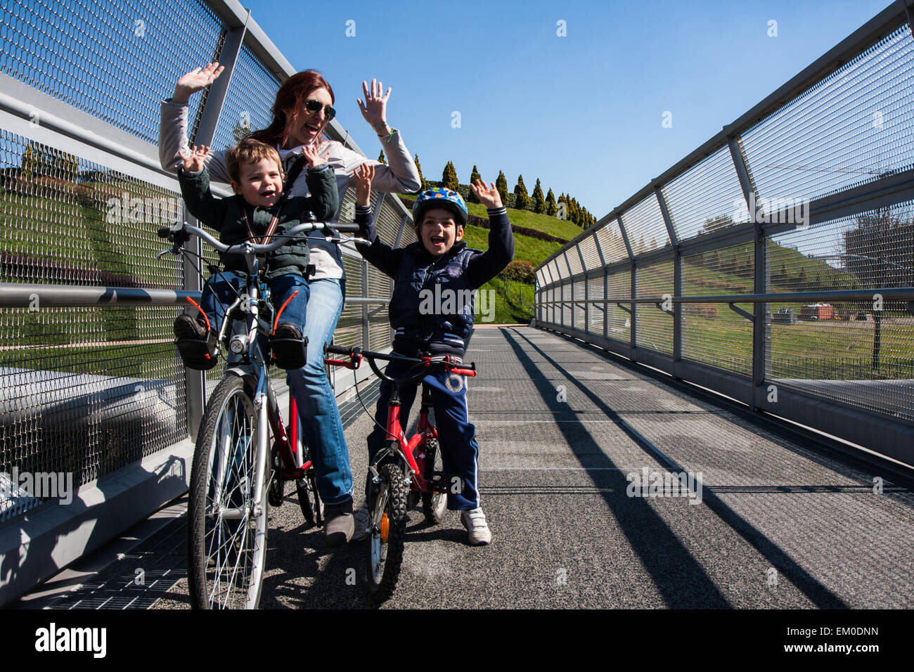 Modern steel cycle bridge that connects the city park Stock Photo