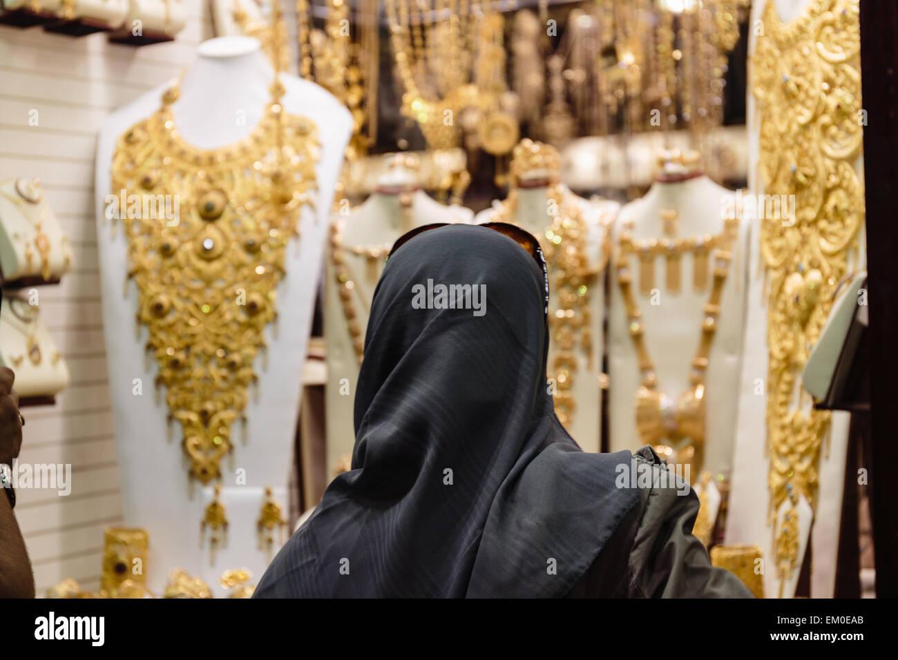 DUBAI, UAE - NOVEMBER 9: Gold market in Dubai on November 9, 2013, Dubai, UAE. The biggest market in Dubai - Stock Image