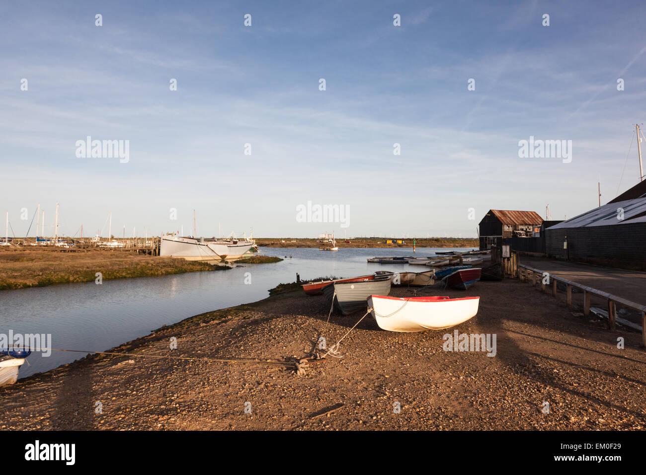 Boats moored on Tollesbury Creek amongst the Saltings, Tollesbury, Essex, UK Stock Photo