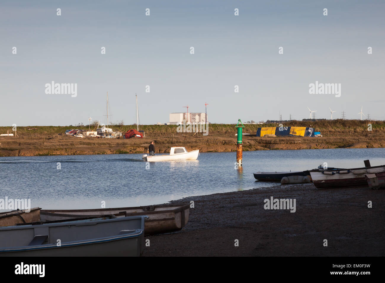 Boats moored on Tollesbury Creek amongst the Saltings, Tollesbury, Essex, UK Stock Photo