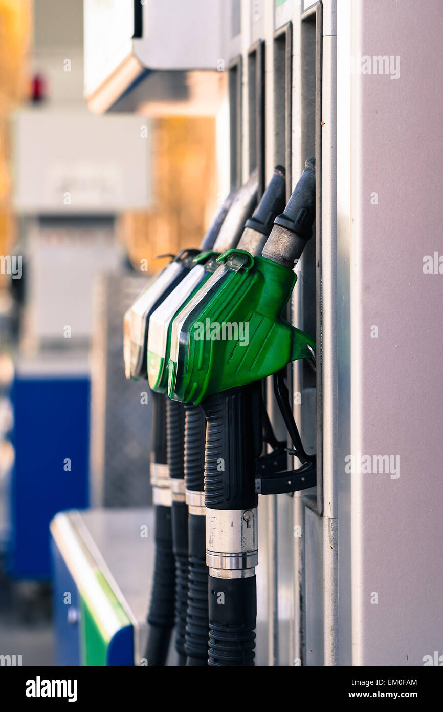 Pump nozzles at the gas station. Stock Photo
