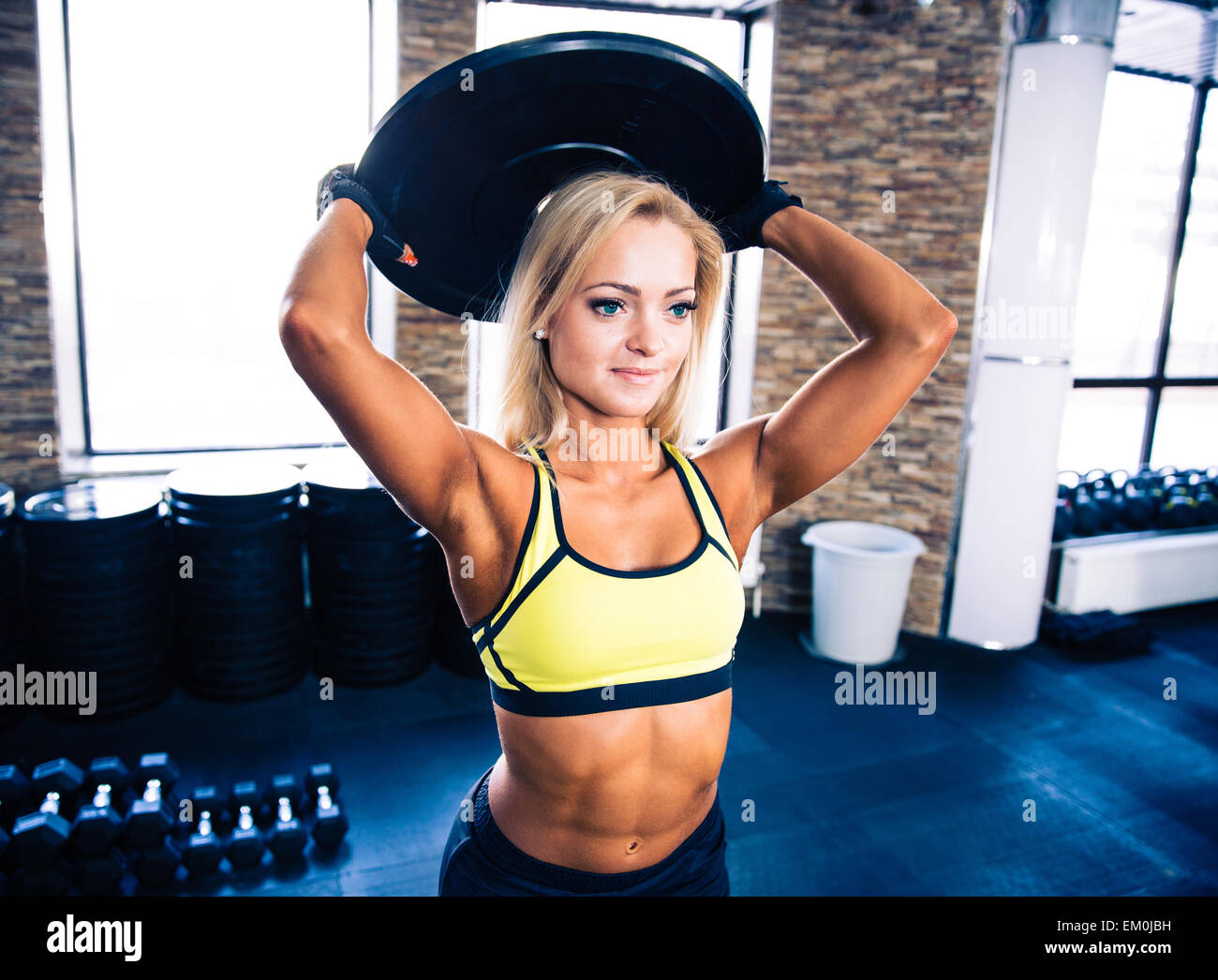 Beautiful fit woman workout at crossfit gym - Stock Image