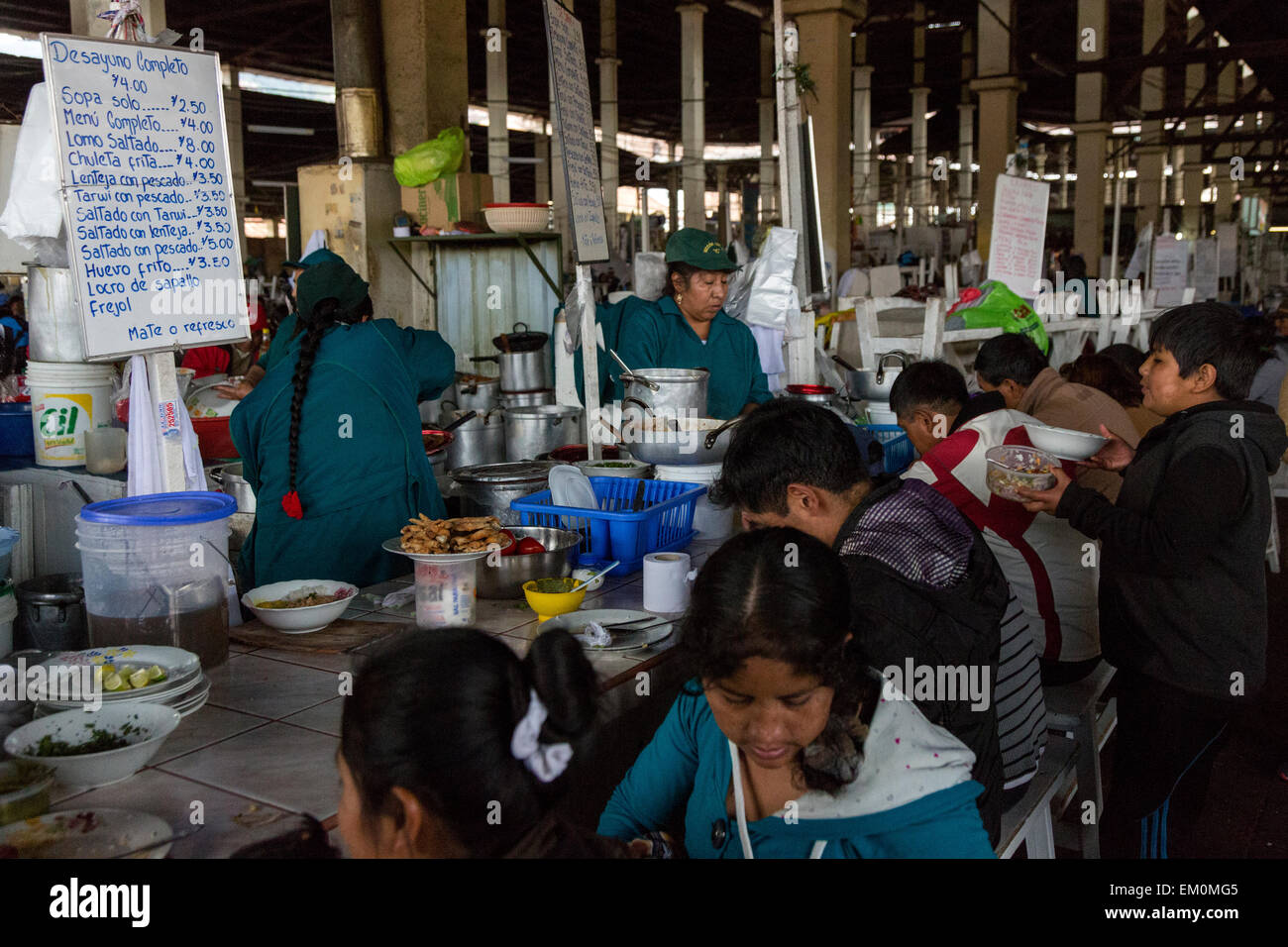 Peru, Cusco, San Pedro Market.  Customers Eating in the Food Court Area of the Market. - Stock Image