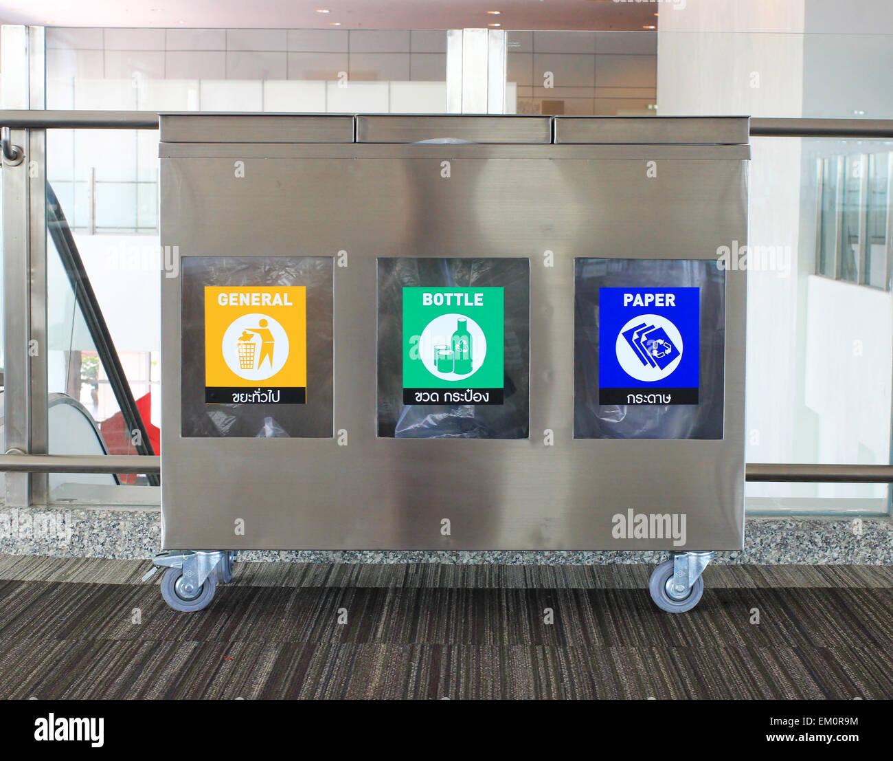 Metal garbage bin in building - Stock Image