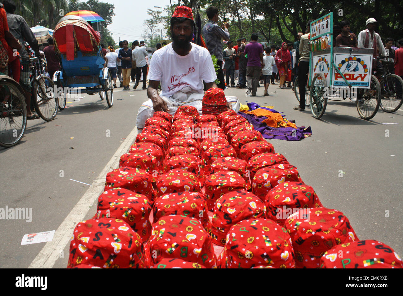 Dhaka, Bangladesh. 14th April, 2015. A street vendor waiting for customers on the street in a celebration day of - Stock Image