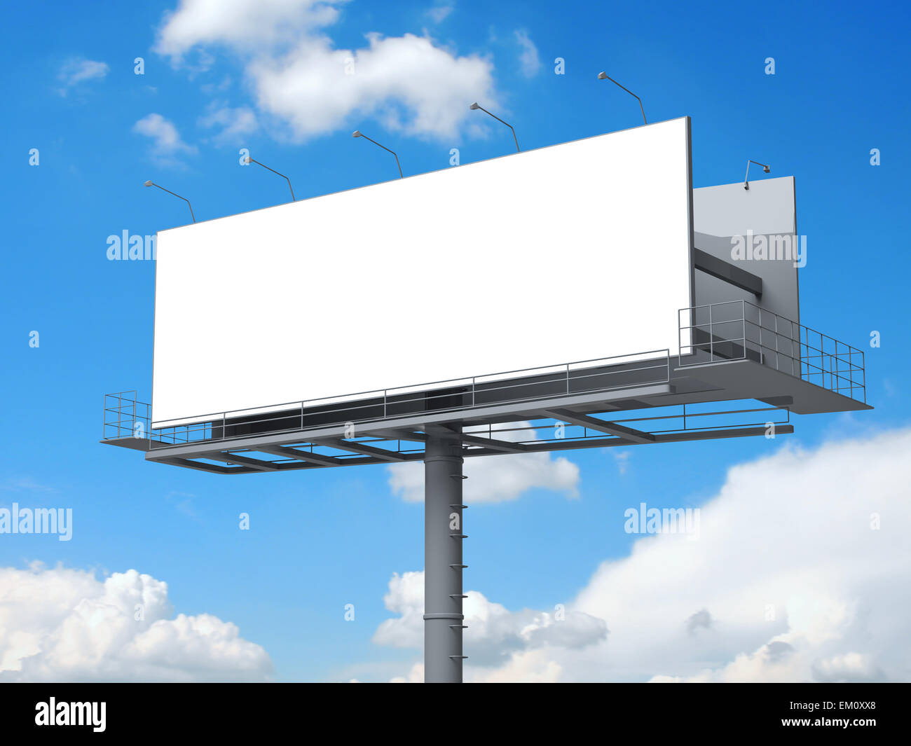 Billboard with empty screen, against blue cloudy sky - Stock Image