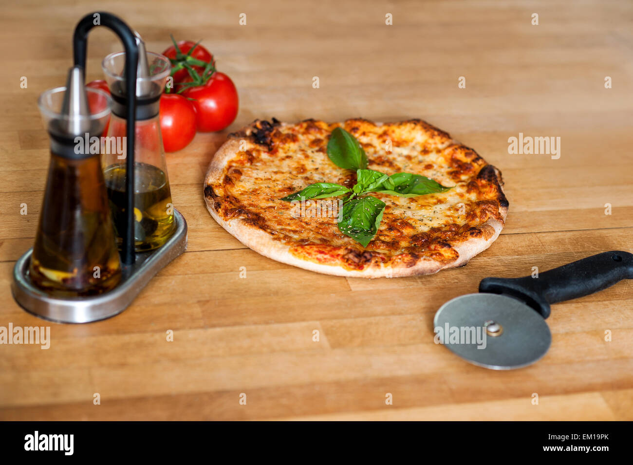Pizza is ready, please help yourself. - Stock Image