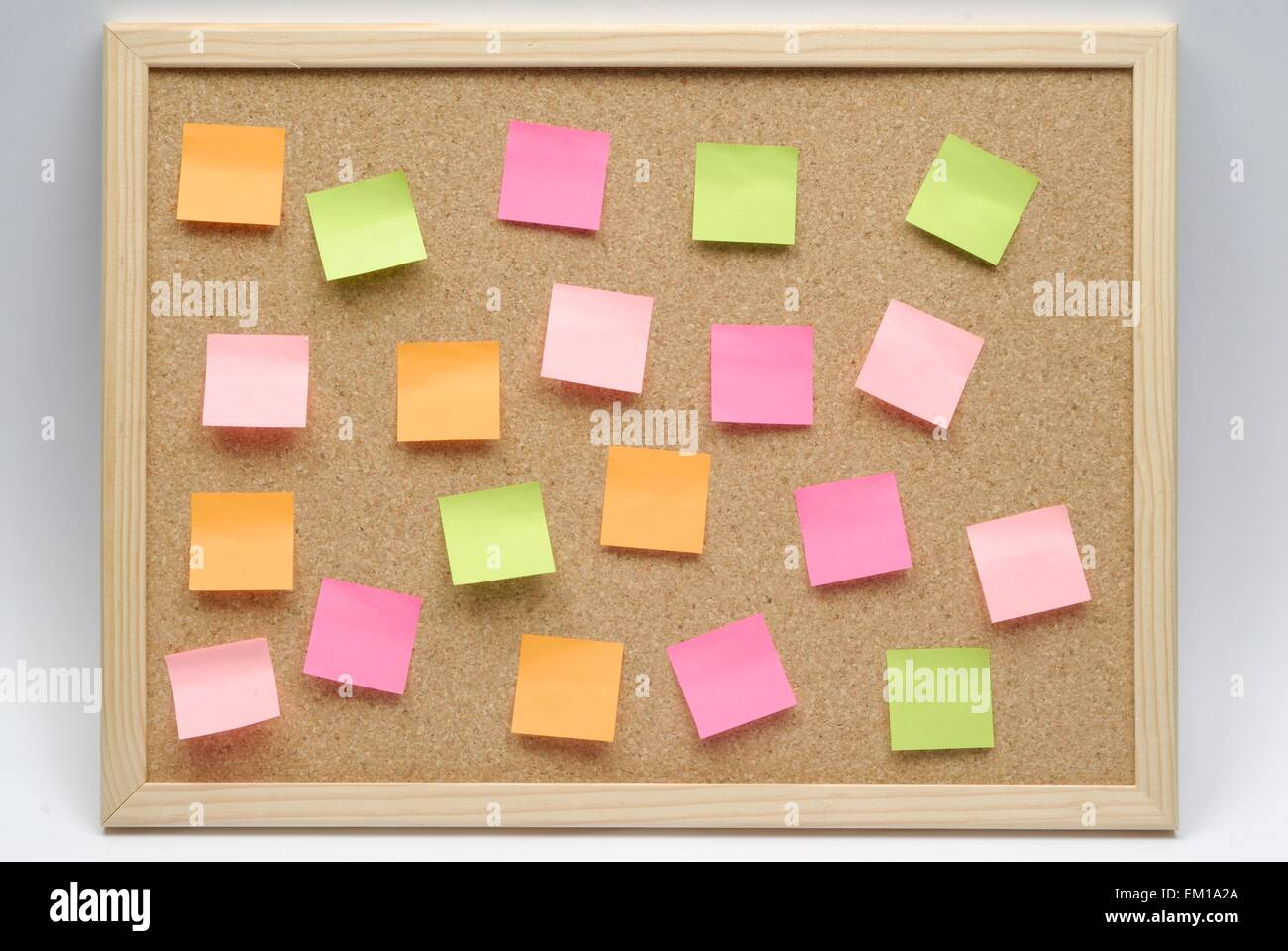 cork board for announcements on white background with paper notes - Stock Image