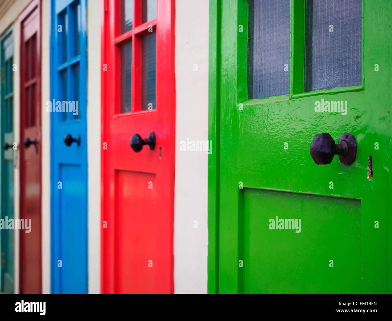A row of painted doors in bright colours at the seaside town of North Berwick in Scotland. & A row of painted doors in bright colours at the seaside town of ...