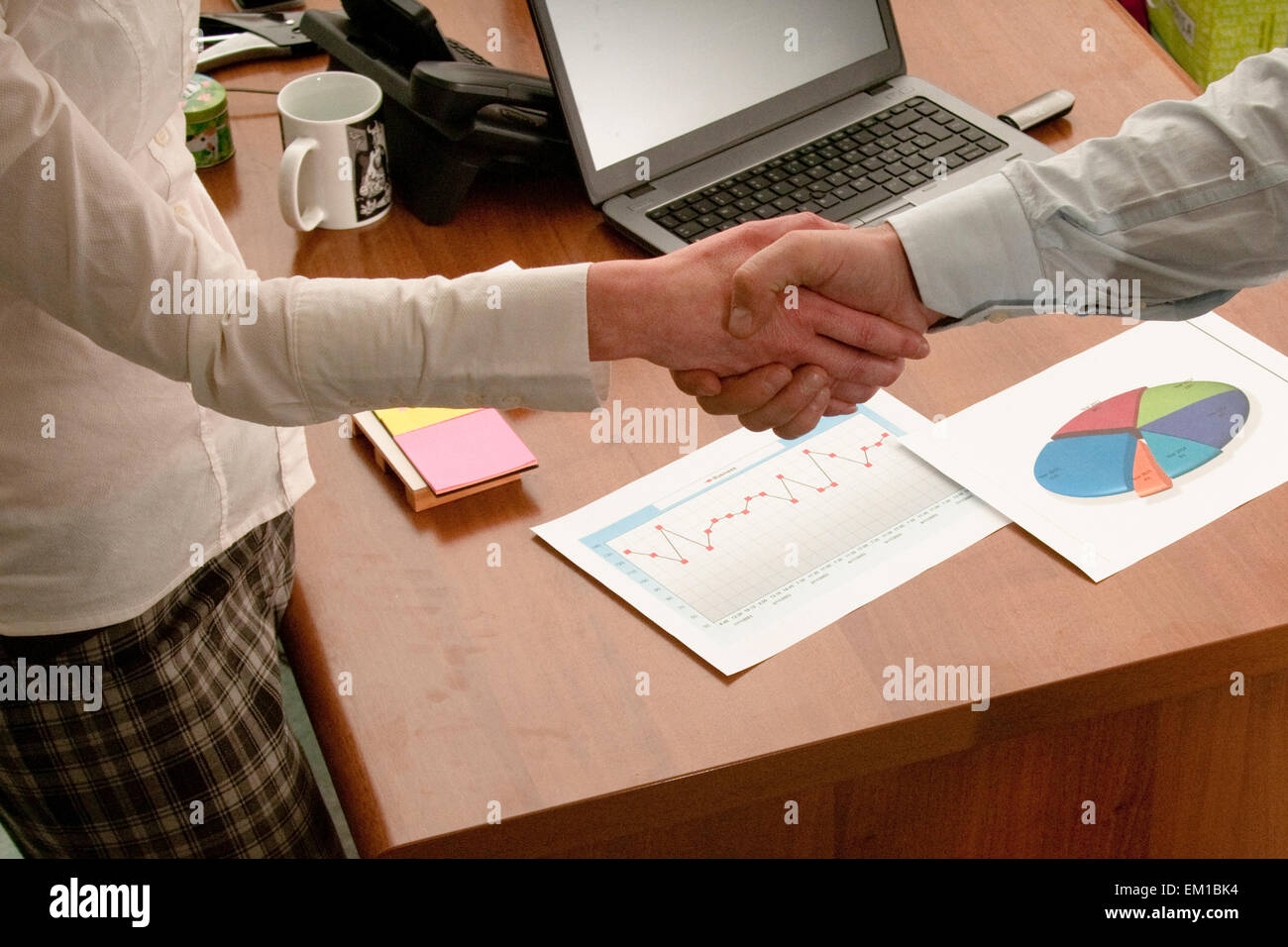 conclusion of a deal and happy business partners - Stock Image