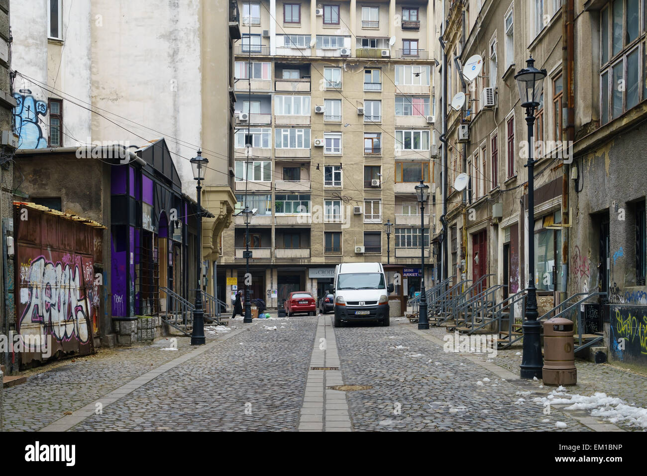 A street and old communist buildings in the city centre of Bucharest, Romania. - Stock Image