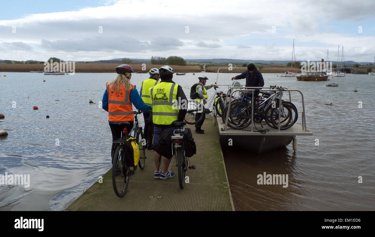Cyclists on NCN route 2 boarding the River Exe ferry at Topsham to cross to the western riverbank. - Stock Image