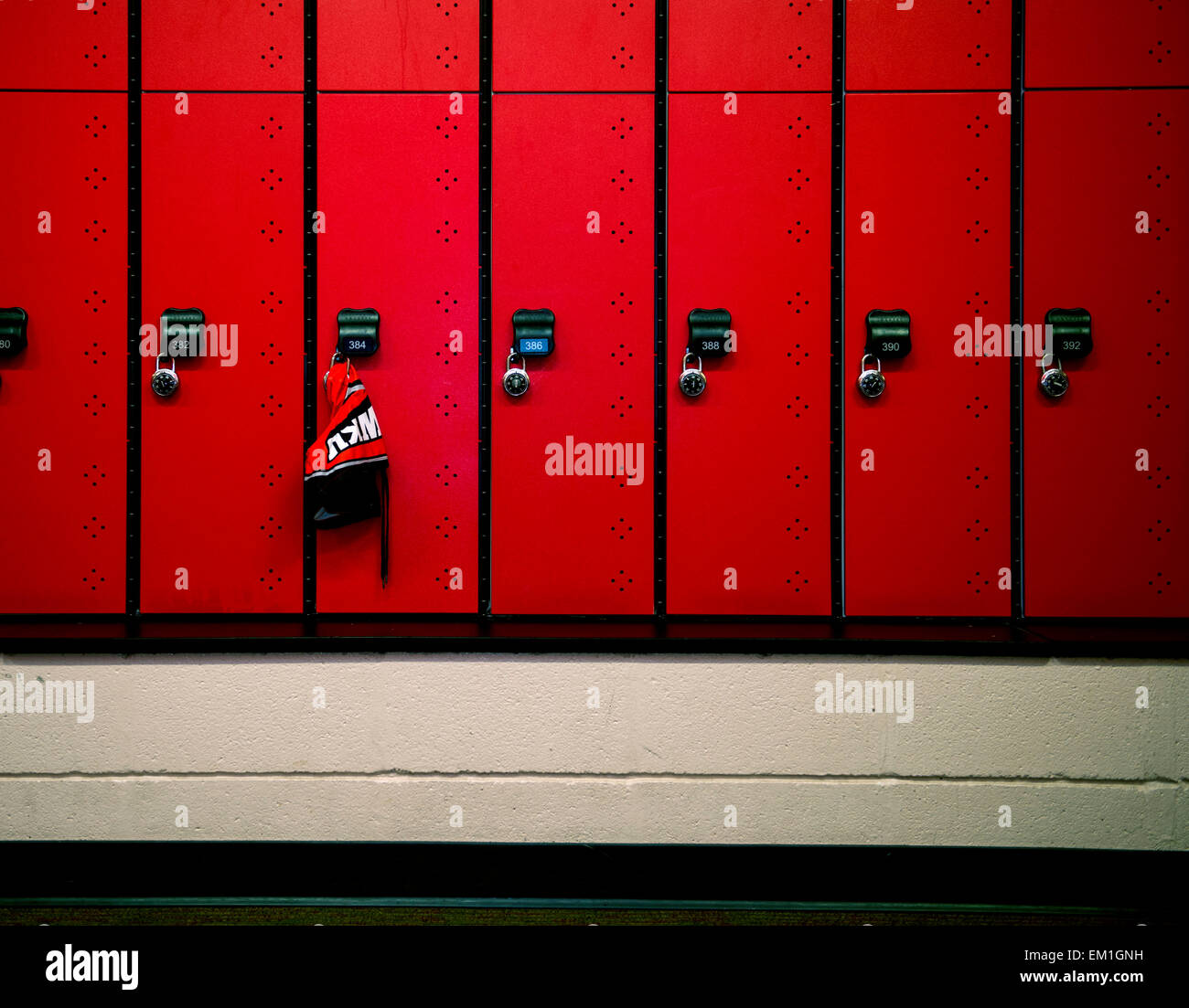 A lone swimsuit hangs out to dry in the Western Kentucky University Men's Swim Team locker room on Tuesday, - Stock Image