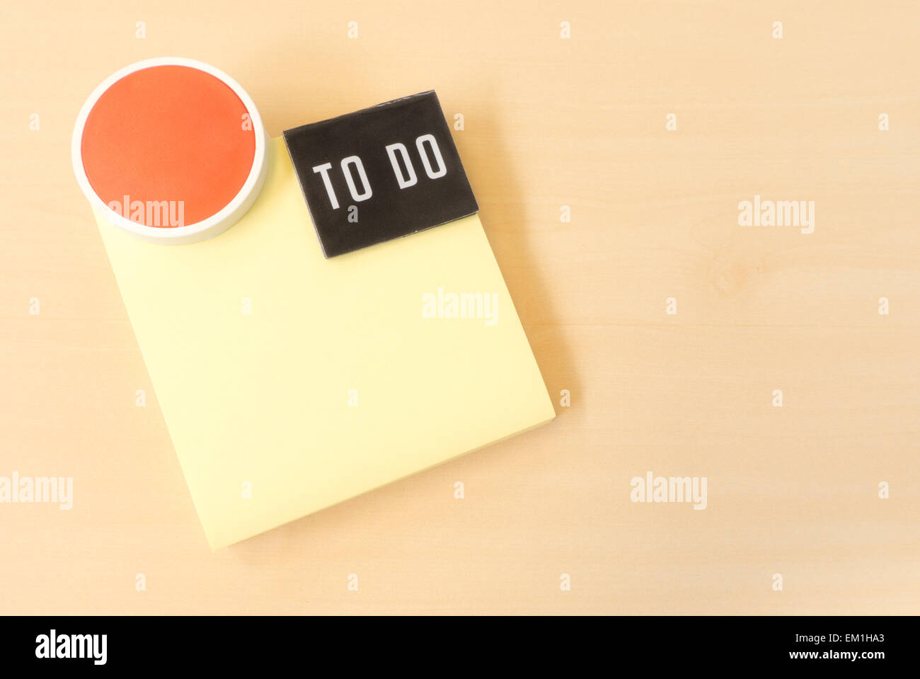 to do list on yellow sticky paper note on brown background stock