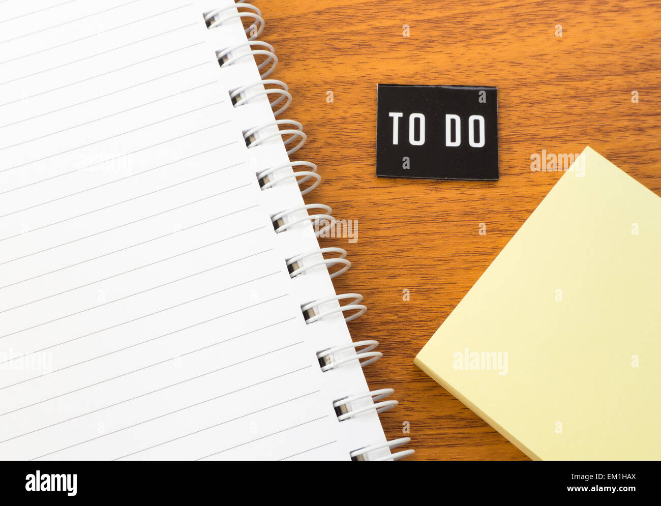 Open Blank Book with To Do List and Yellow Postit on Wooden Table - Stock Image