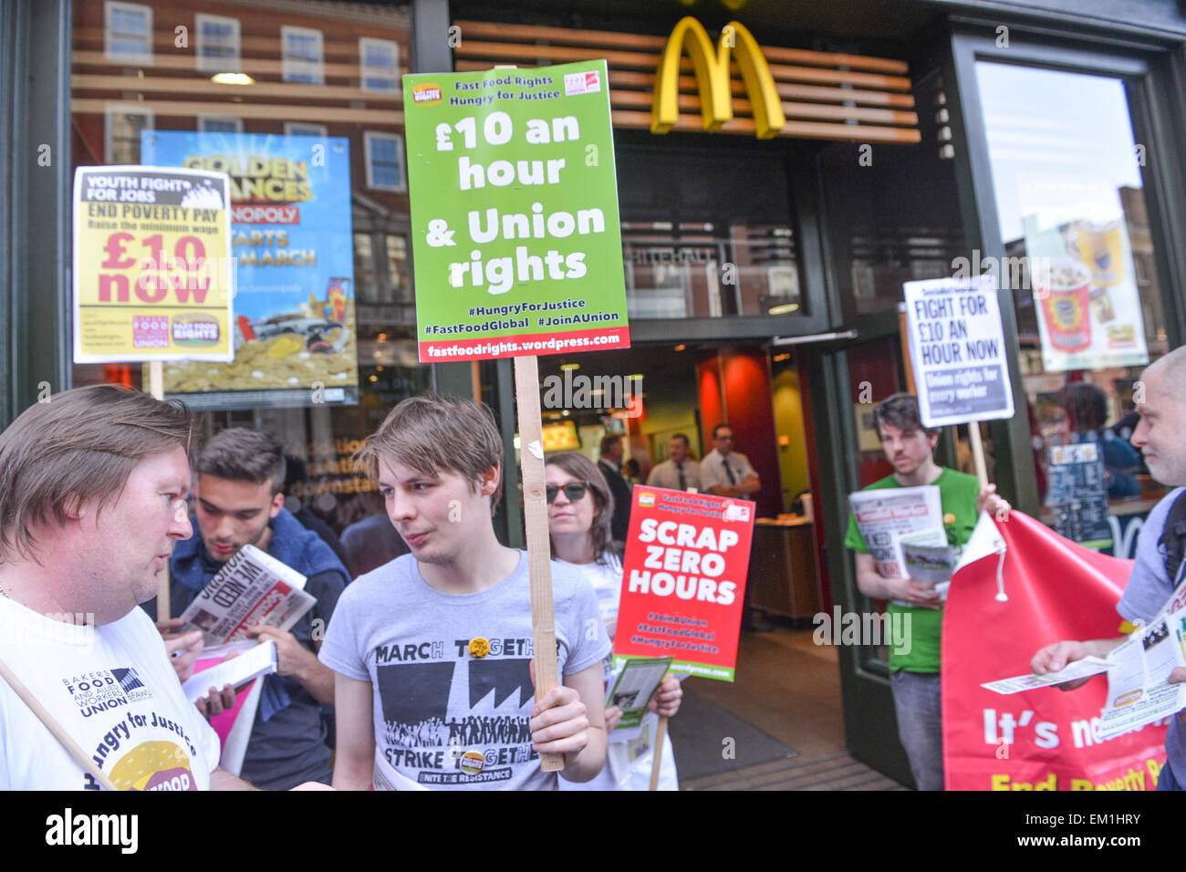 Whitehall, London, UK. 15th April 2015. 'Fast Food Rights', protesters stand outside McDonalds on Whitehall - Stock Image