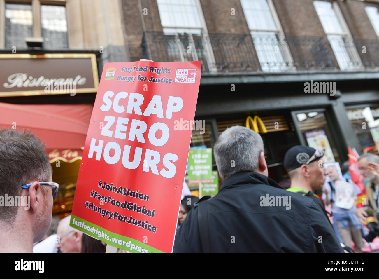 Whitehall, London, UK. 15th April 2015. 'Fast Food Rights', protesters stand outside McDonalds on Whitehall in central Stock Photo