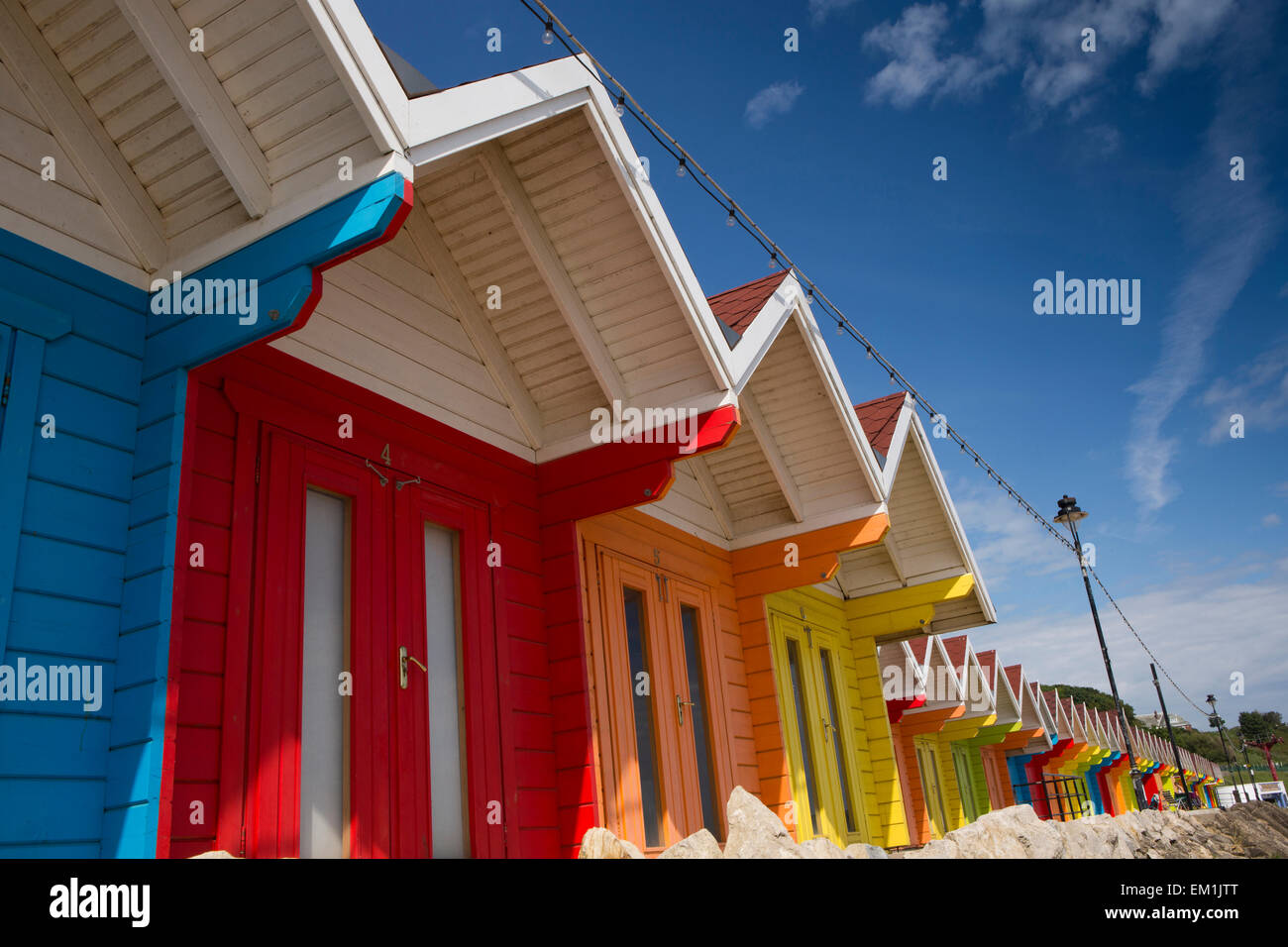 UK, England, Yorkshire, Scarborough, North Bay Promenade, colourfully painted beach huts - Stock Image