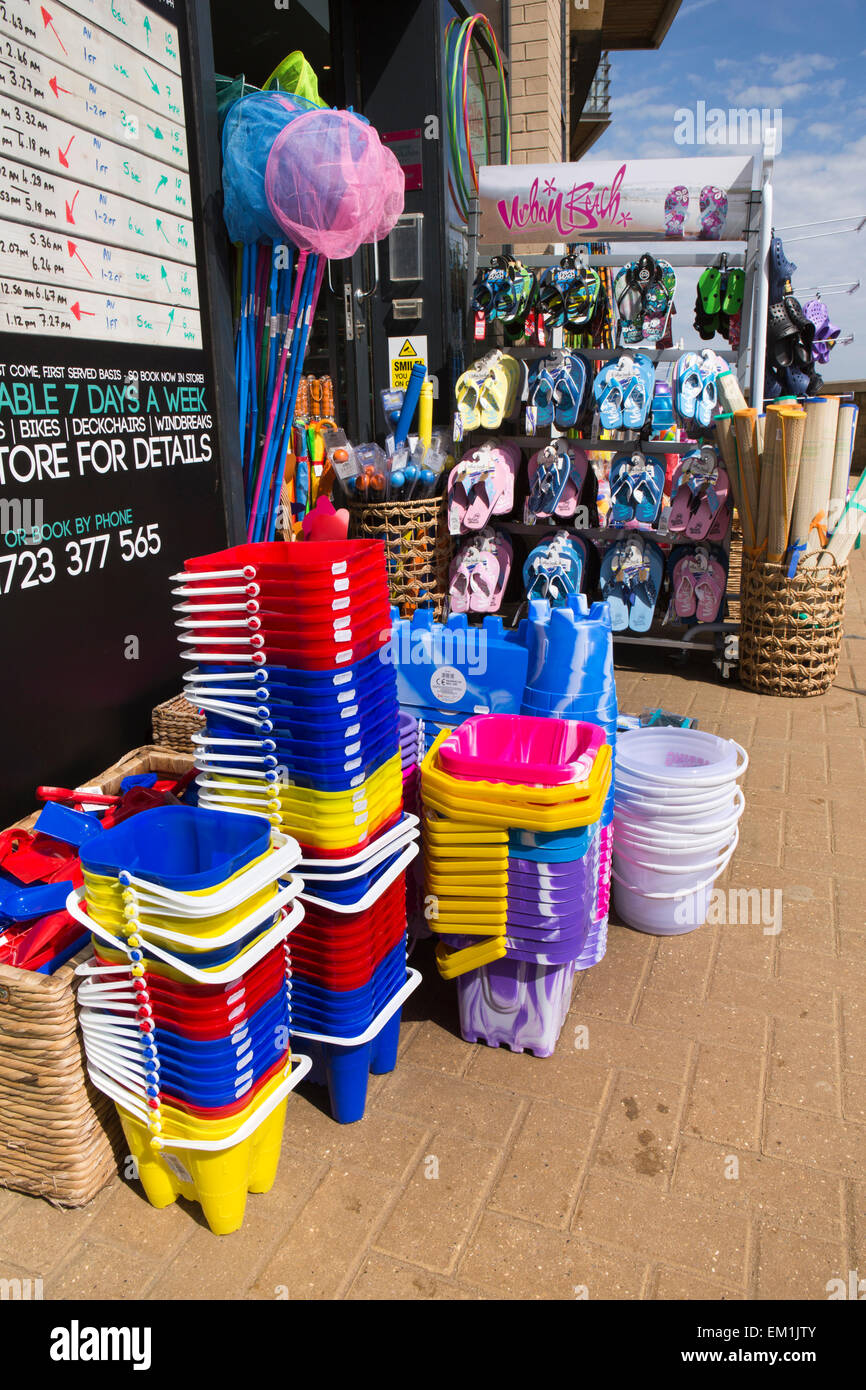 UK, England, Yorkshire, Scarborough, North Bay Promenade, plastic spades in beach supplies shop - Stock Image