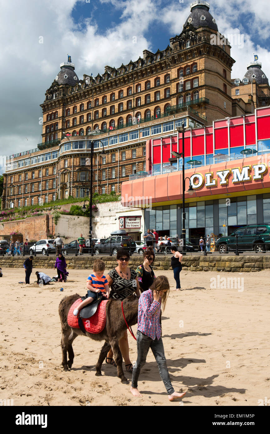 UK, England, Yorkshire, Scarborough, South Sands donkey giving ride to child Stock Photo