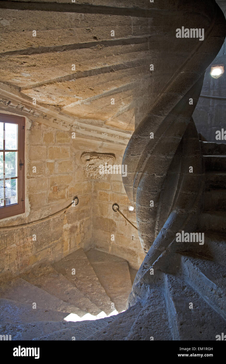 Twisting interior staircase in the medieval wing of the Chateau de Lourmarin, Provence, France. - Stock Image