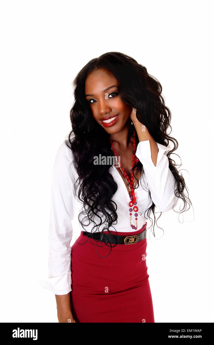 9270403d25 A halve length picture of a black girl in a white blouse and red skirt and  long curly black hair standing isolated for white