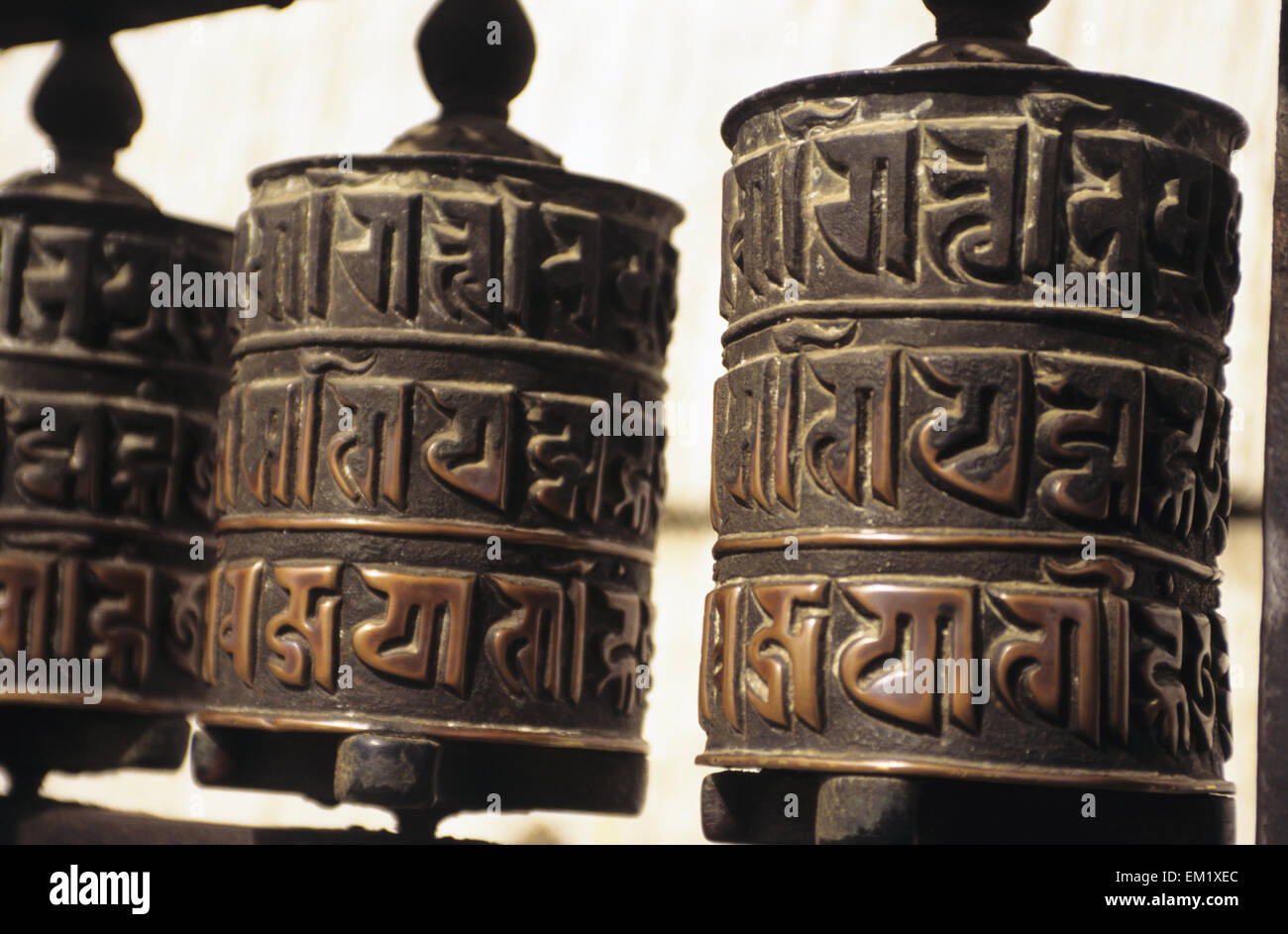 Nepal, Swayambhunath Temple; Kathmandu, Close-up of prayer wheels with carvings - Stock Image