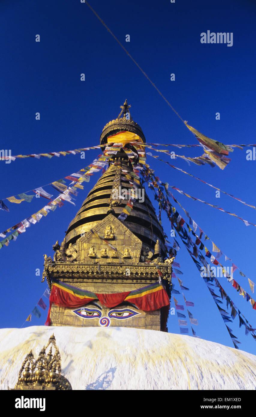 Nepal, Colorful flags hanging from top on Swayambhunath Stupa; Kathmandu - Stock Image